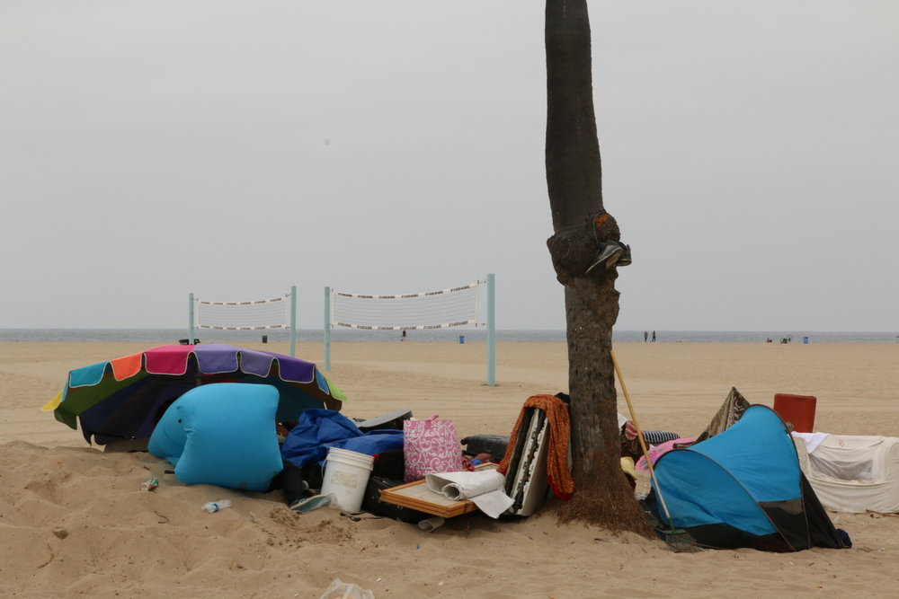 Homeless encampments on the along the boardwalk in Venice, CA. Photo credit: Adriana Cargill