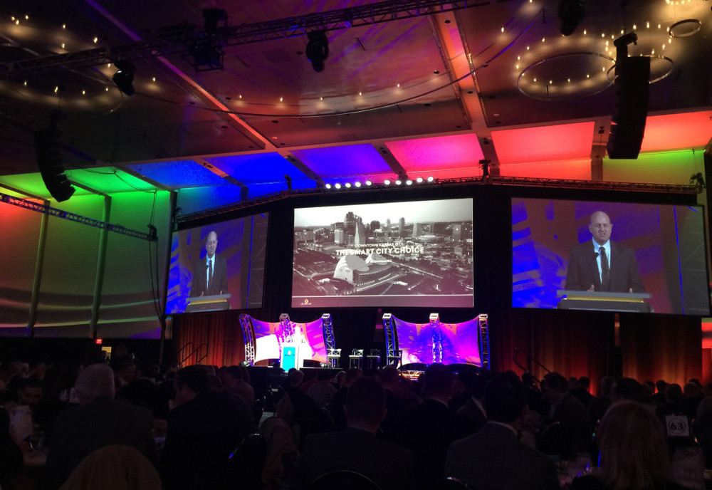 Jon Copaken addresses more than a thousand attendees at the Downtown Council's annual luncheon on Friday.