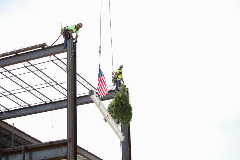 JE Dunn crews place the last structural beam on the new Lenexa Civic Center.