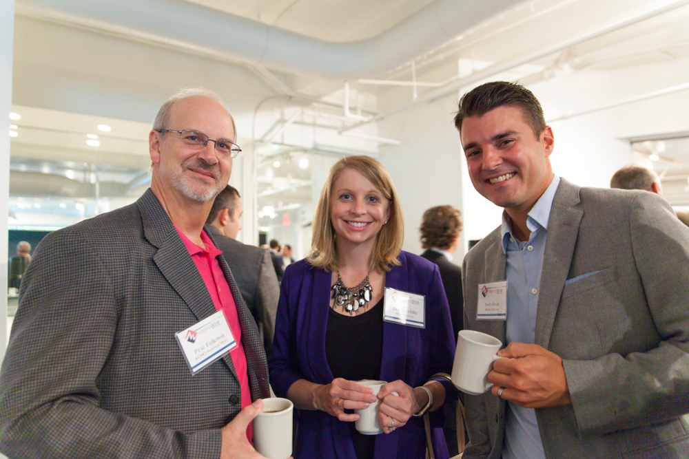 Pete Fullerton of the KC Aviation Department with Sarah Schiltz and Josh Beck of MarksNelson. Photo by Jacia Phillips.