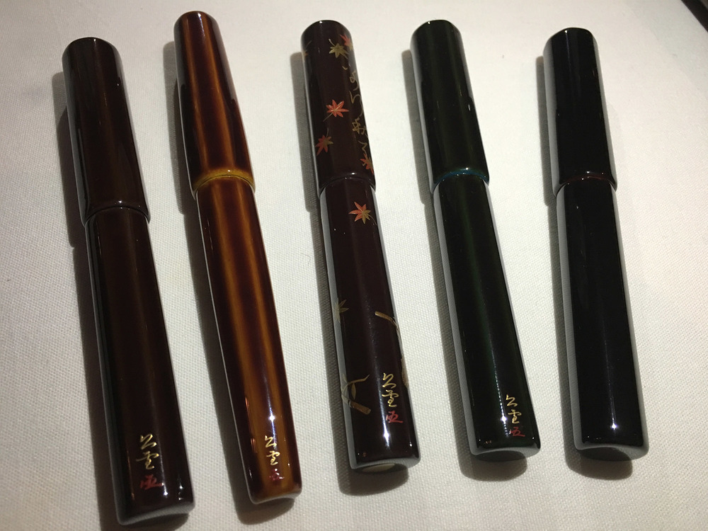 My Danitrio along with Thomas Hall's collection. I like how the same artist worked on our pens (note the signature at the bottom of the barrel in kanji.)