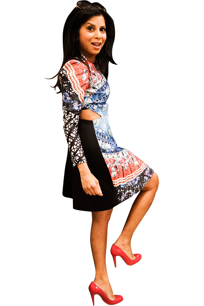 Hitha Herzog in a neoprene Clover Canyon kaleidoscope dress and red Louboutin pumps.