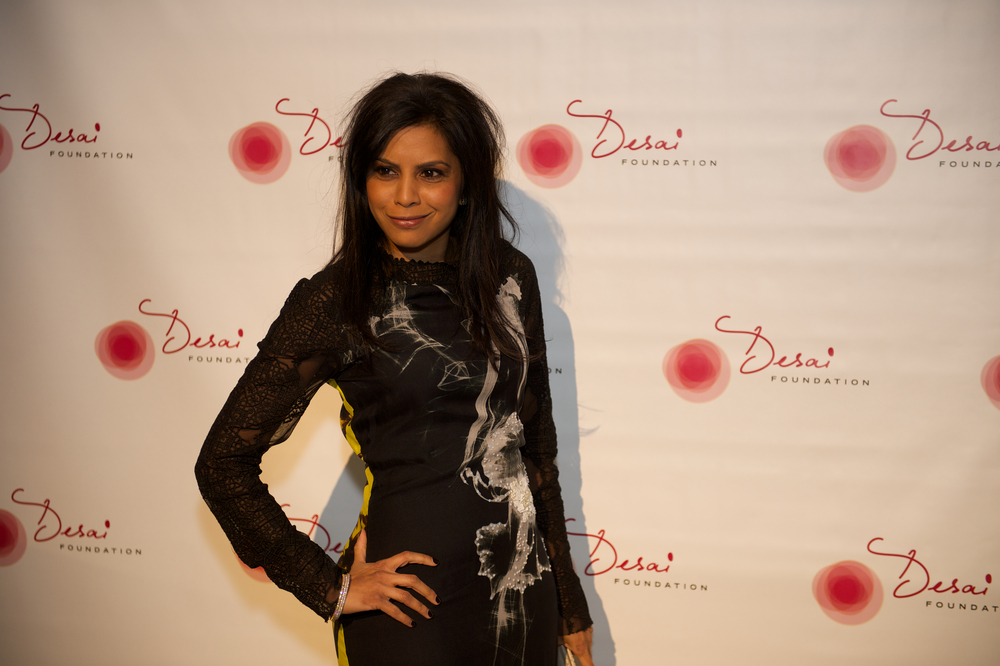 Hitha Herzog in a patterned long sleeve black dress at the Desai Foundation Gala.