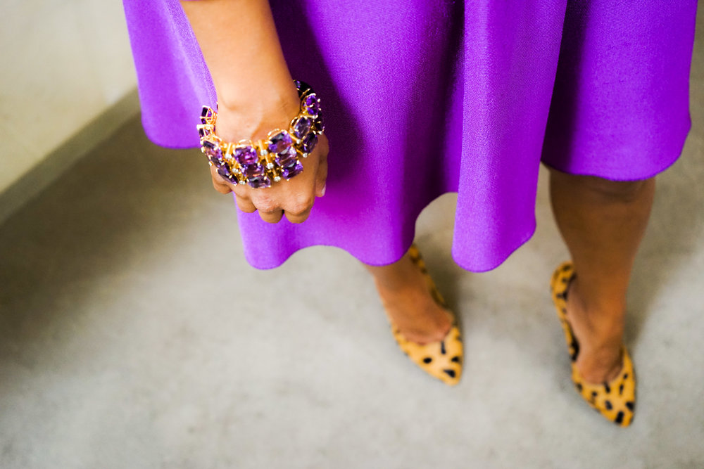 Hitha in Tony Duquette, a stunning violet dress, and cheetah print high heels.