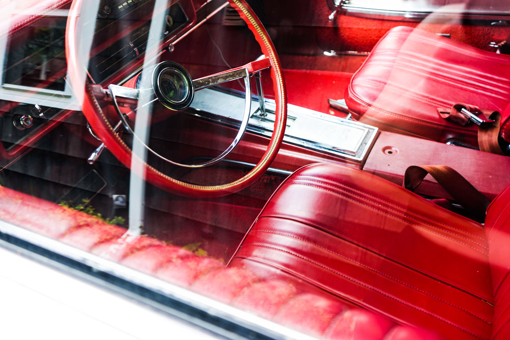 Beautiful vintage car with cherry red upholstery.