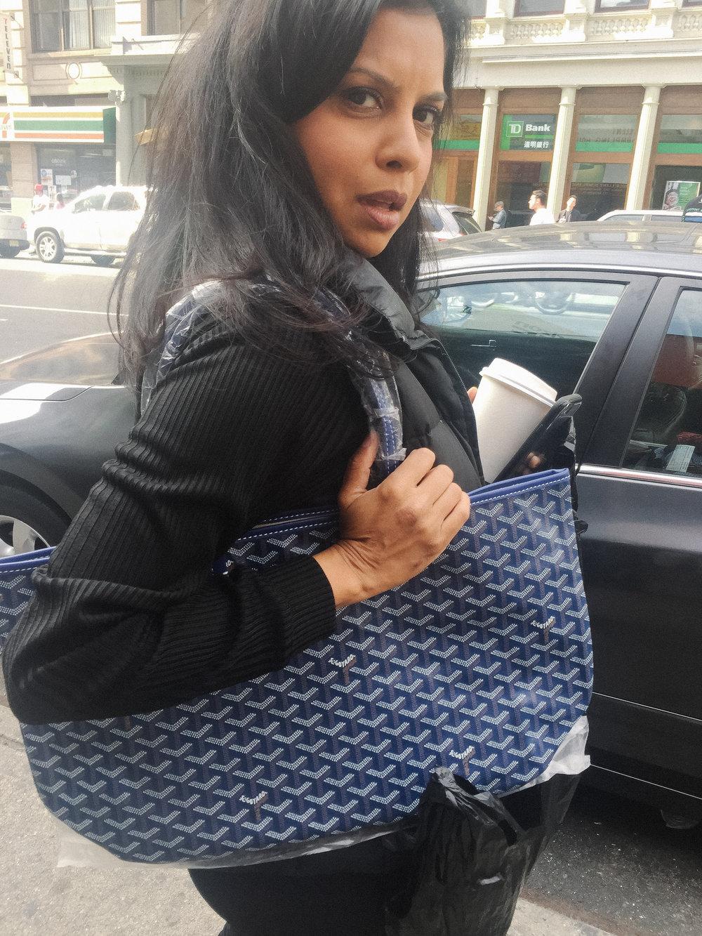 Hitha Herzog carrying a fake Goyard handbag in Chinatown