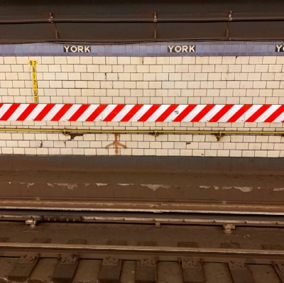 York St. subway platform waiting for the Manhattan-bound train.