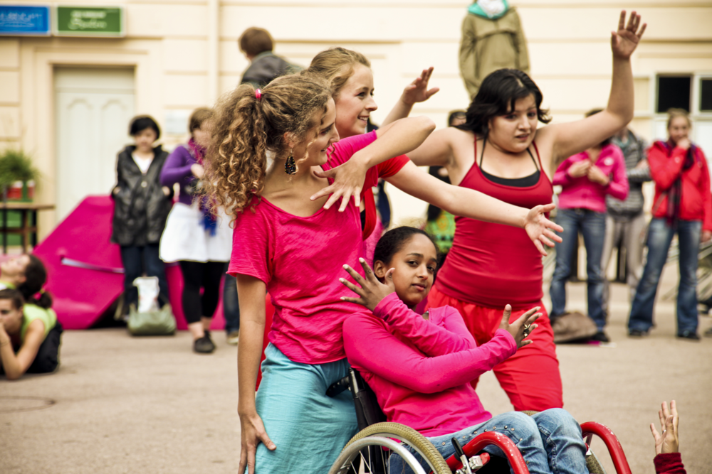 Image: four young mixed ability dancers perform for a crowd. PHOTO CREDIT:  MartaLamovsek