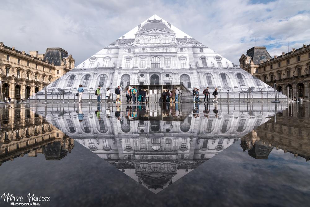 JR art work at Louvre Pyramide