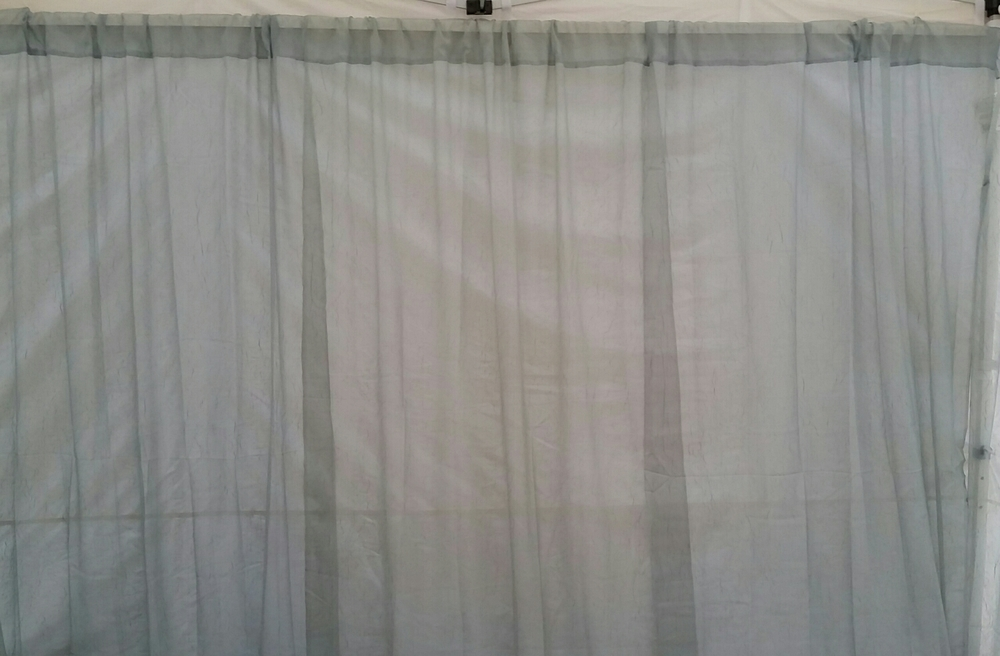 We recently redesigned the booth and these curtains were a new bit of color. They are a pale green and with the sunlight in the booth, they add the perfect touch.