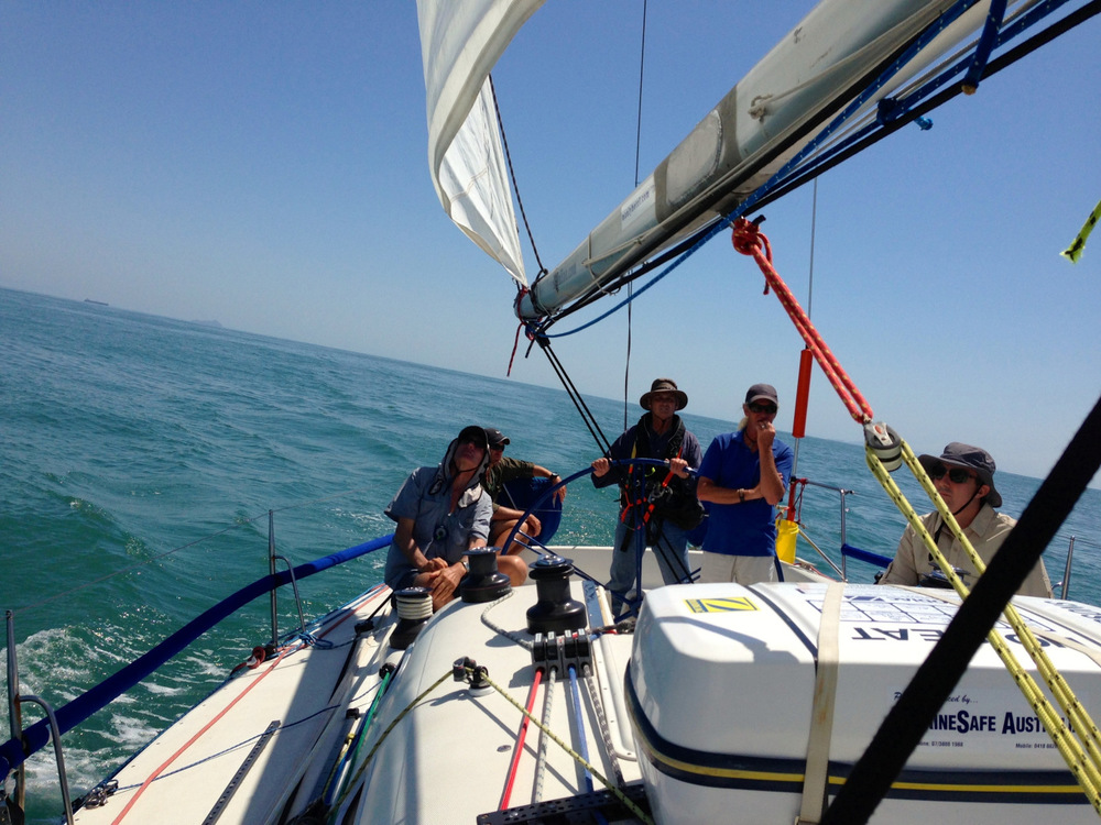 Sailing down the Queensland coast on Oceans. Instructor Steve in the blue shirt