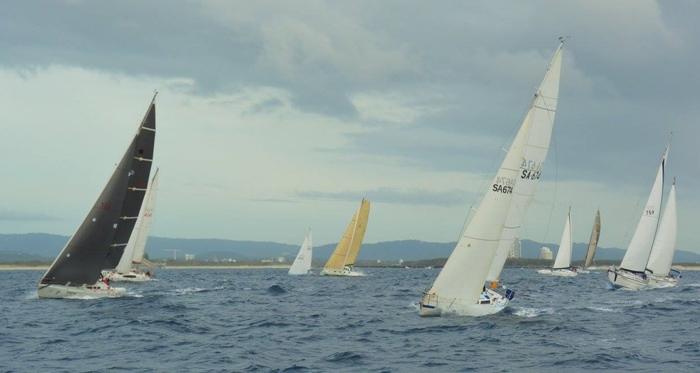 The fleet heads off the start line to windward of Ocean Gem. Leeway was our target to beat on left.