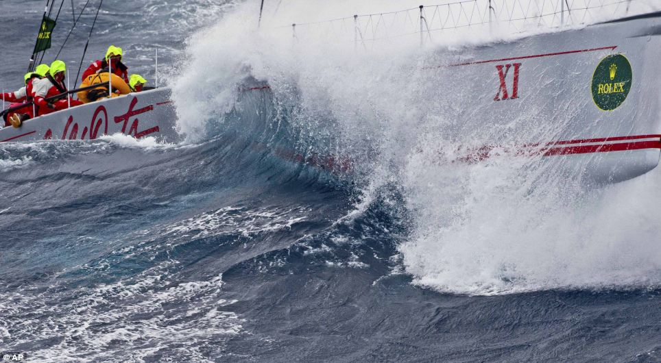 The 100 foot super-maxi 'Wild Oats 11' powers to windward in the Sydney to Hobart Race