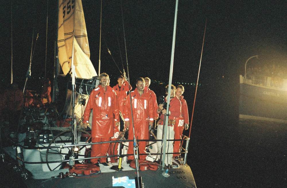 Lion New Zealand arriving in Hobart after completing Sydney to Hobart Race with Peter Blake, and Peter Montgomery in front from left to right