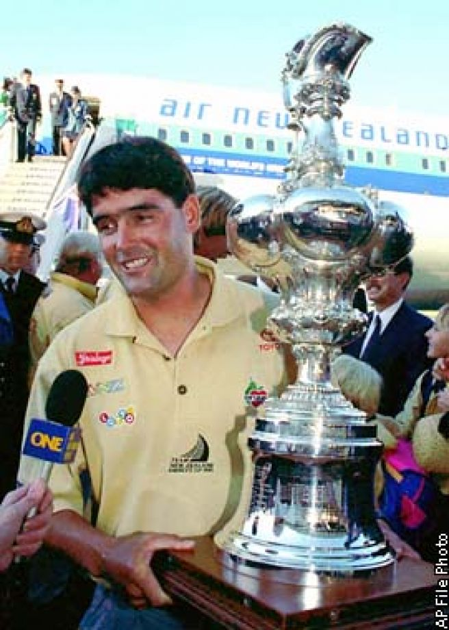 Russell Coutts steps off the plane onto New Zealand soil, with the Americas Cup in hand in1995