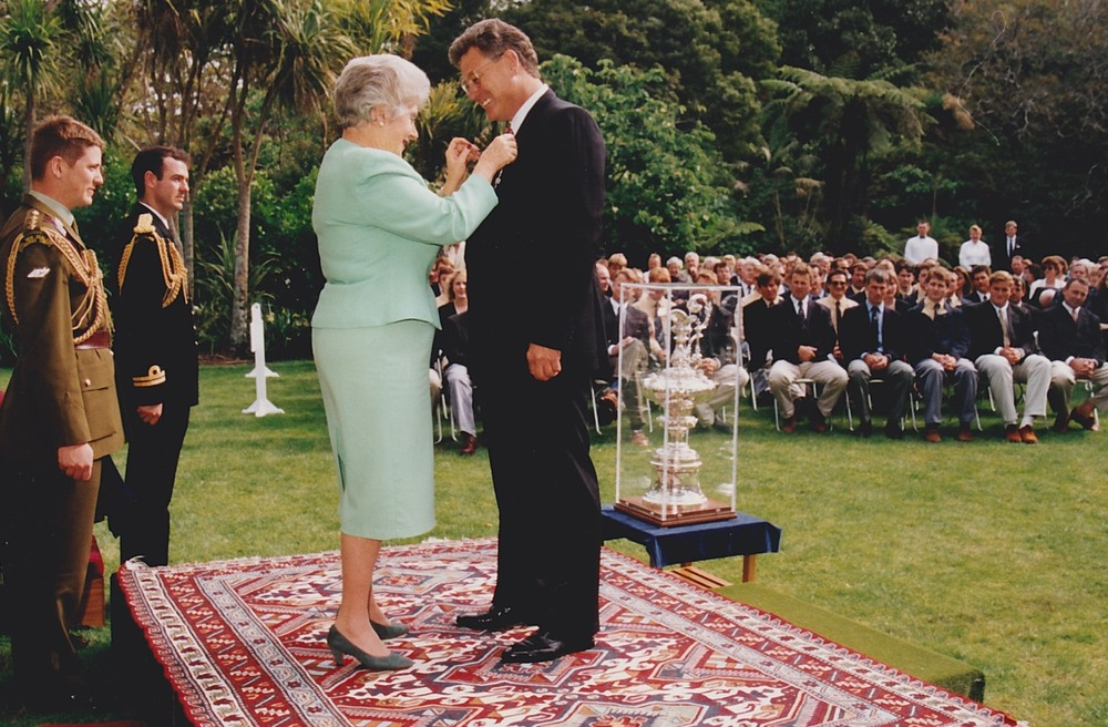 Peter Montgomery awarded an MBE by New Zealand Governor General Dame Cath Tizard in 1995