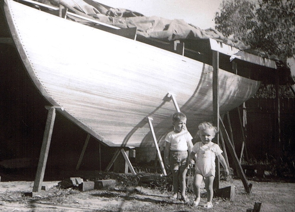 Andrew with his sister Jackie in front of the families boat building project