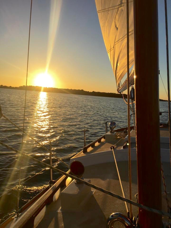 The sun sets as Andrew takes Jackie R for a sail on the Clarence River