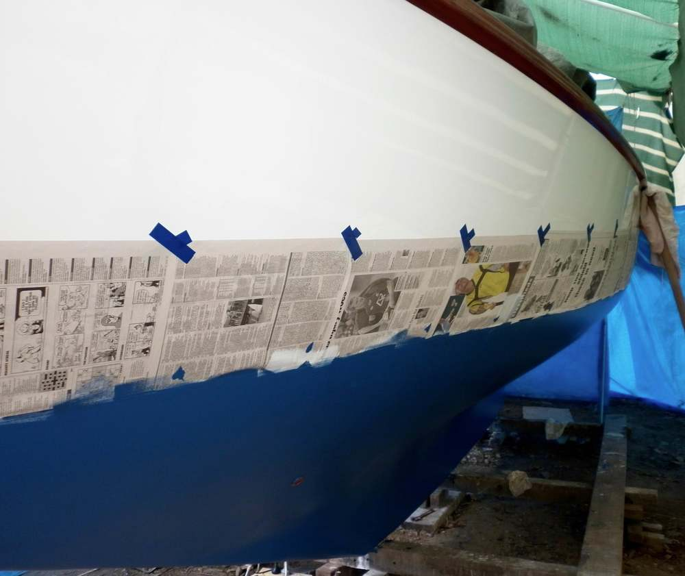 The anti-fouling paint goes on after the topsides have been finished