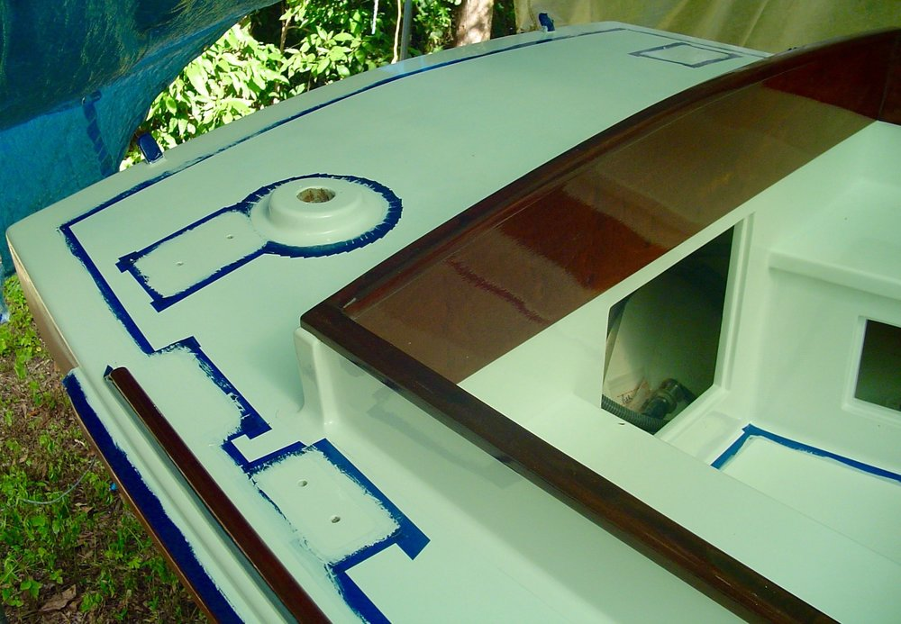 The painting and varnishing is underway on the cabin top