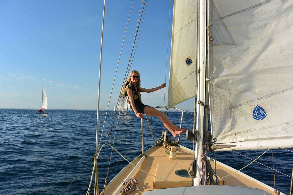 Jessica enjoying the sunshine while sailing on Queensland waters