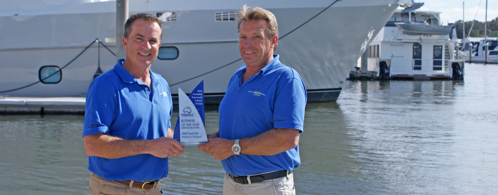 Steve Sammes and Kym Fleet of the Gold Coast City Marina with one of many awards