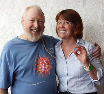 Derek Droscher, Festival Organiser, shares a magic moment with Festival Patron, Isla St Clair.