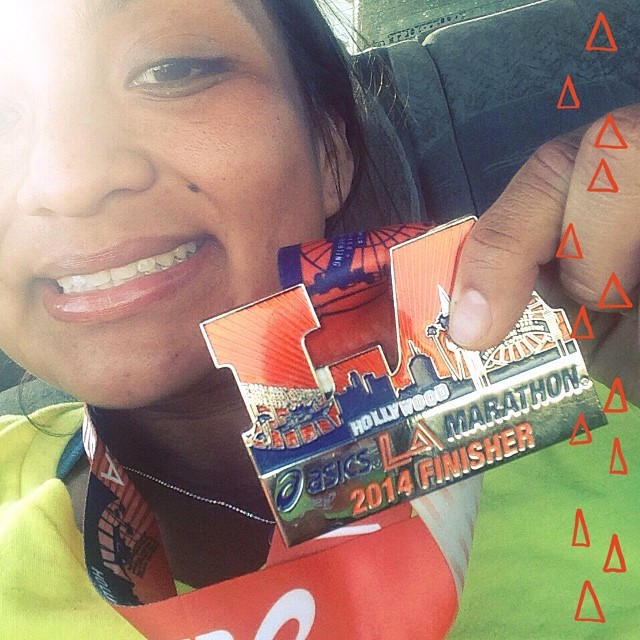 My LA Marathon finisher's medal and I, March 2014.