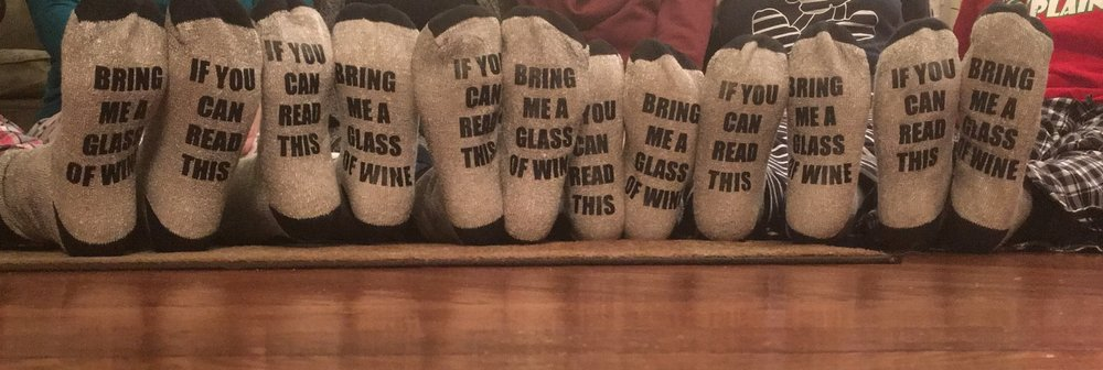 Can you guess which feet are mine?   Here's a clue...I always think outside of the box.  I just want my wine!