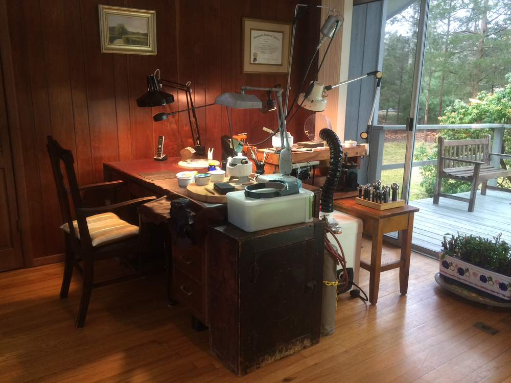 The soldering and filing station. Workshop is in a bright cheerful space.