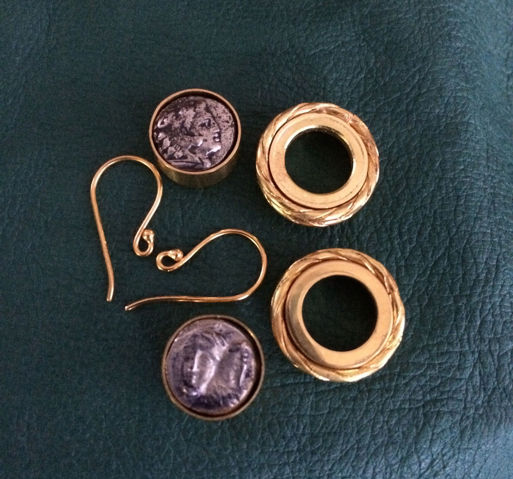 Student's work in progress. Ancient coin 22 karat gold earrings.
