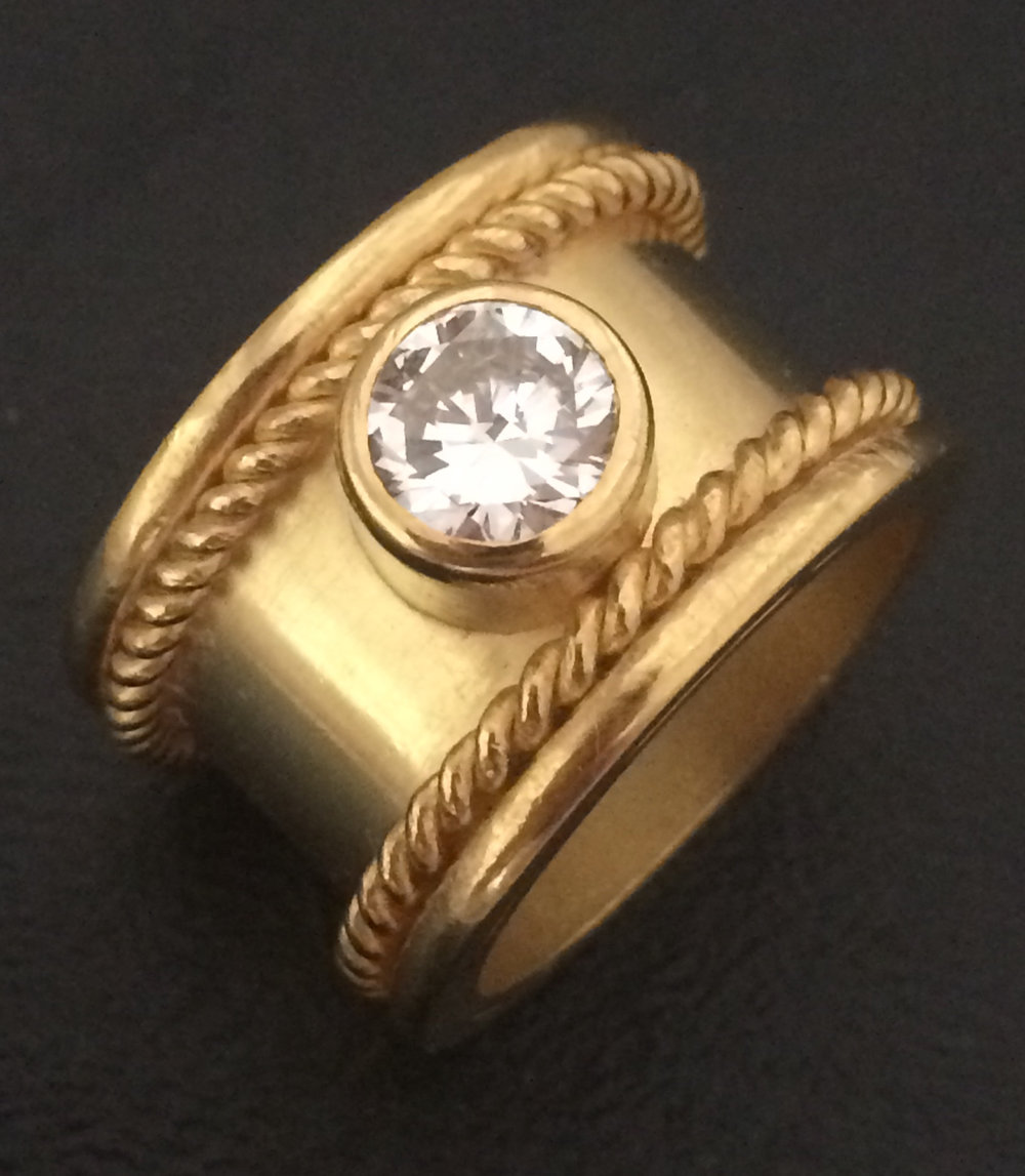 Advanced student's finished work. Diamond and 22 karat gold band.