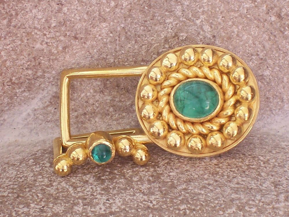 Cabochon emerald belt buckle with keeper in 22 karat gold.