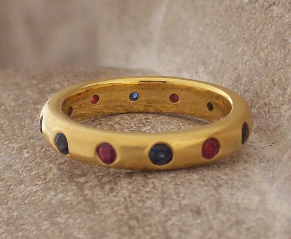 Sapphire and ruby band in 22 karat gold.