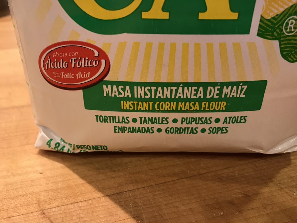 Masa marina (instant corn masa flour). This brand is Maseca, but that's not the only one out there.