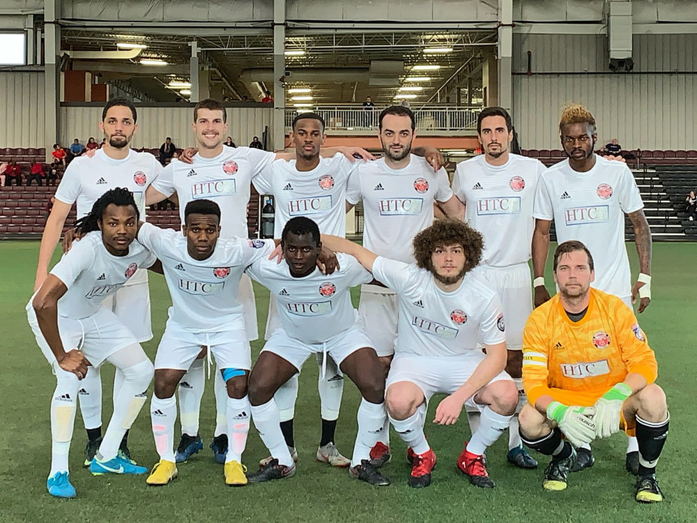 The Michigan Stars FC defeated Livonia FC 1-0 on a goal by Michel Allou (at left in front row) assisted by Steven Juncaj (second from left in back row)