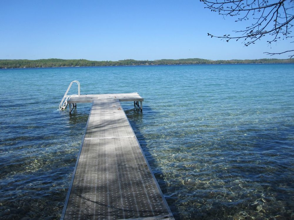 The dock from the grounds of Majila to Torch Lake.