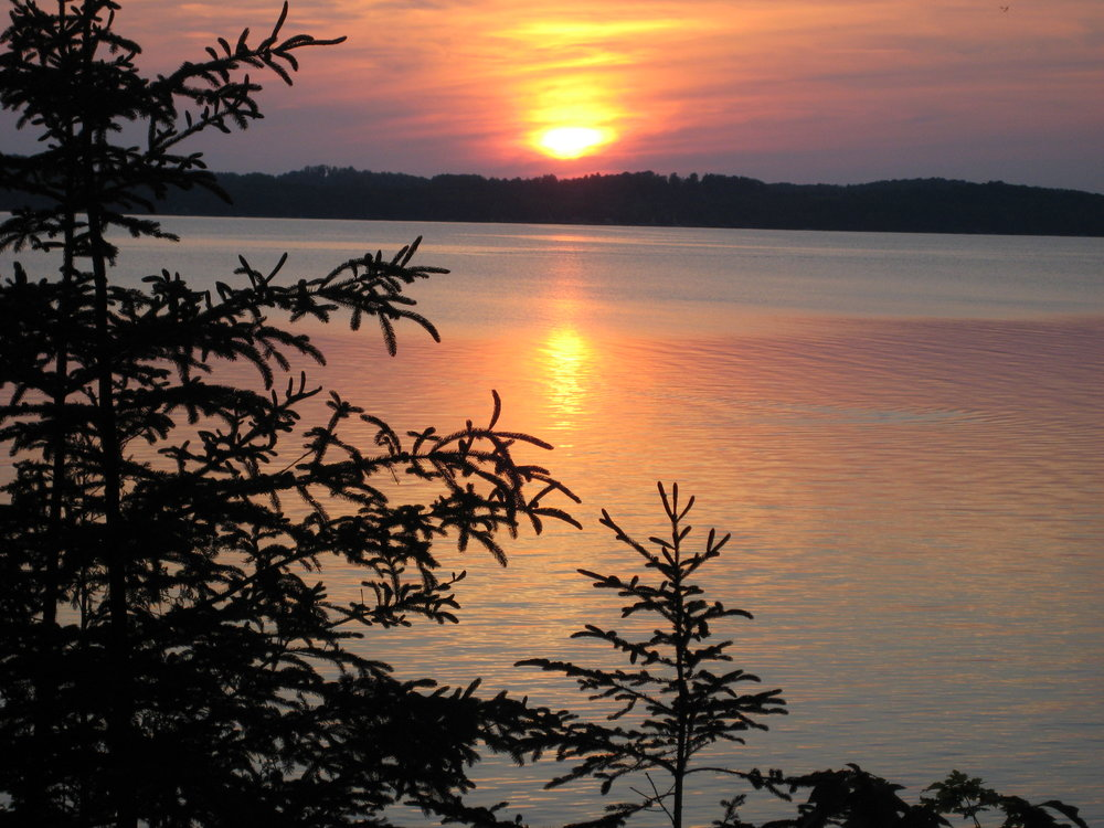 The sun setting over Torch Lake at Majila.