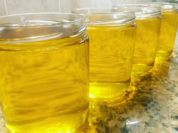 Freshly poured ghee resembles LIQUID GOLD.  Photo by Radha Schwaller 2016