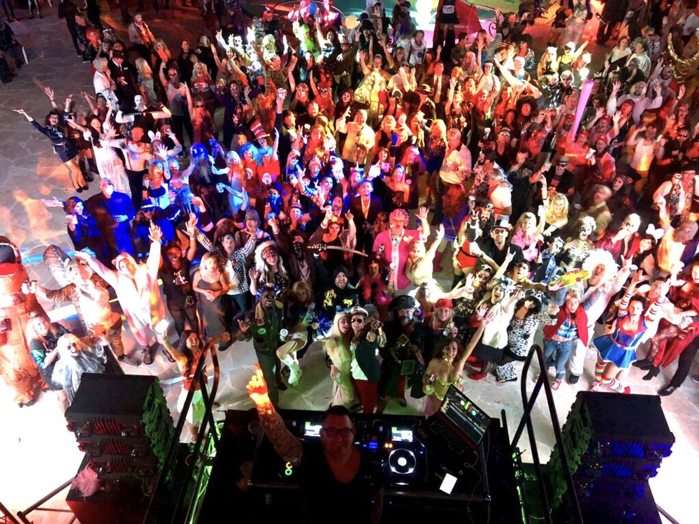 "Crowd shot of Alys Beach ""Noche de los Muertos"" at the Caliza Pool with Jason Jani."