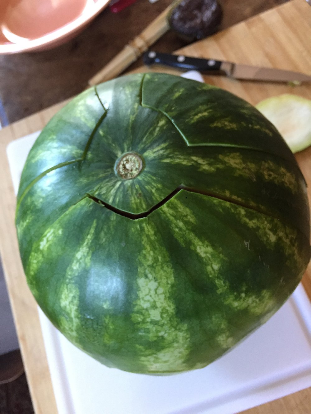 1. - After taking a thin slice off the base to stabilize, carve the design with a paring knife. Watermelons are easier to cut than pumpkins!