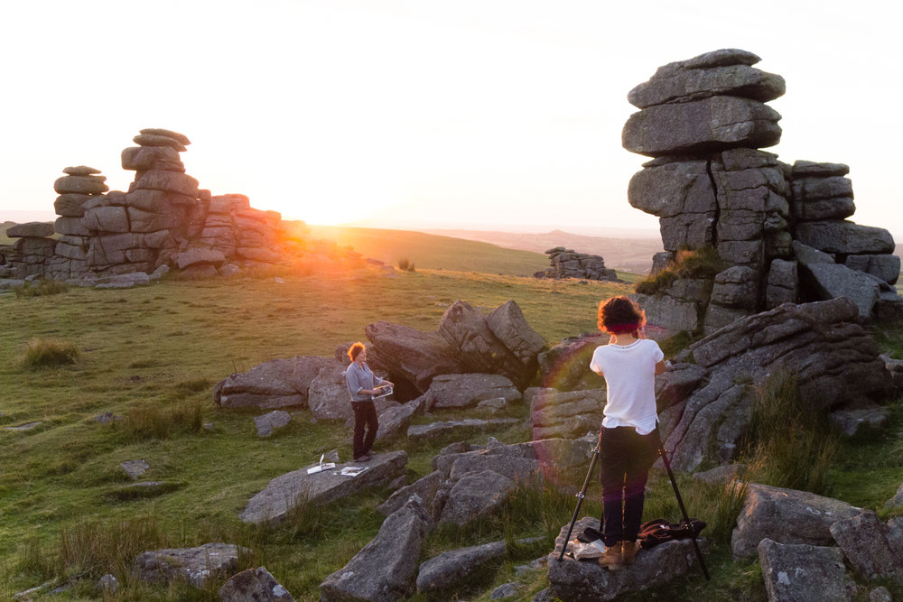 Suzy Bennett photographs Dartmoor printmaker Anita Reynolds sketching at Great Staple Tor.
