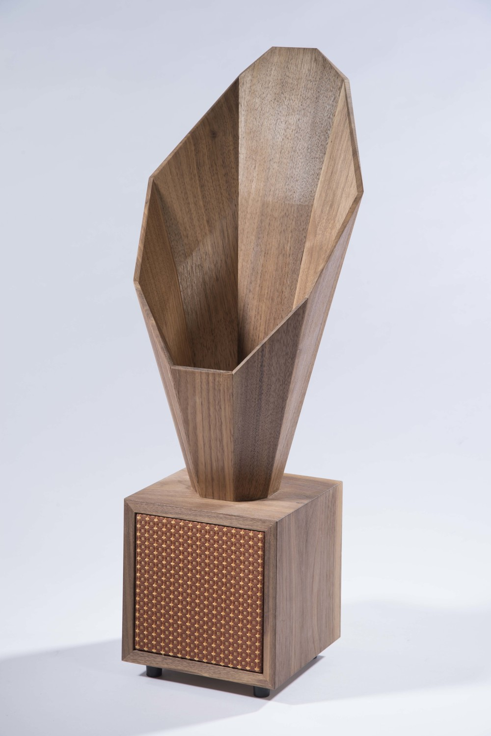 """Desktop Horn Speaker is a set of two rear loaded horn speakers, utilizing a set of 3"""" full range speakers. The horn on top of the enclosure amplifies the lower frequencies from the rear of the speaker, resulting in a fuller sound.    Materials: walnut wood, mesh textile  H 20"""" x L 8"""" x W 8"""""""