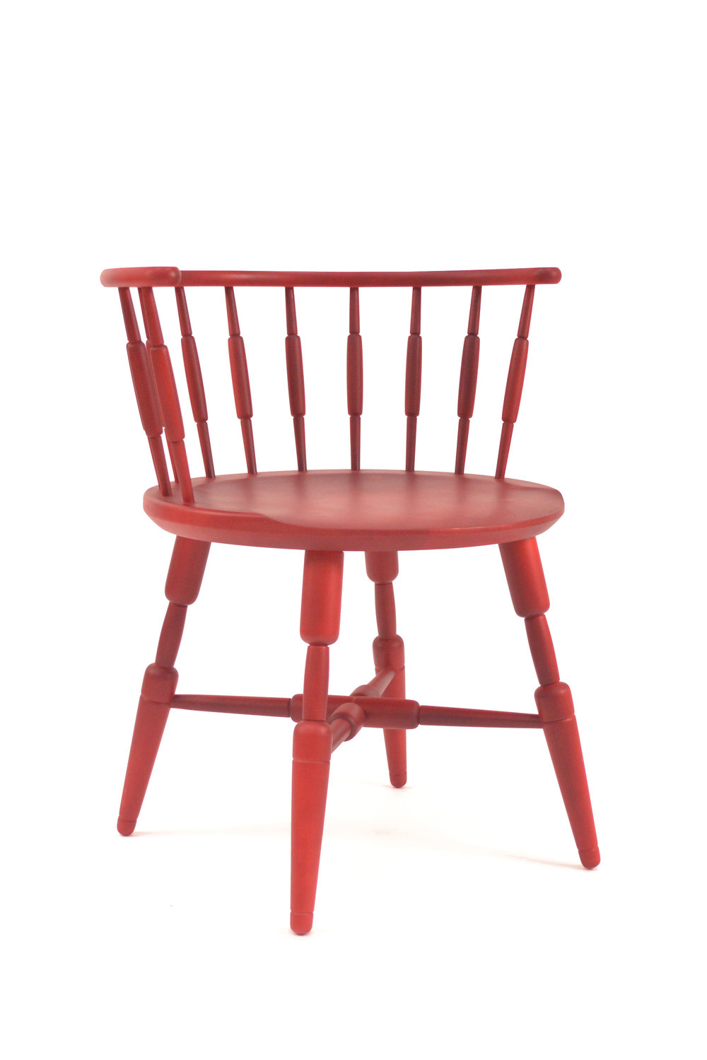"Sausage Link Chair is a take on a traditional low back windsor chair. The spindles and seat are manipulated to appear soft and malleable, such as the transitioning fleshy weight seen in sausage links.  Materials: Dyed Hard Maple  H 29"" x L 22"" x W 24"""