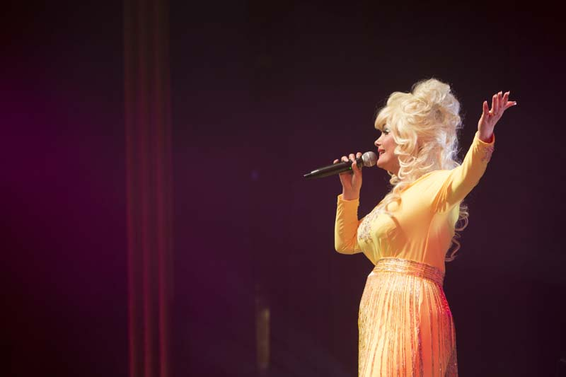 """Dolly Parton"" performs her greatest hits in The Entertainers' production, ""Islands In The Stream""."