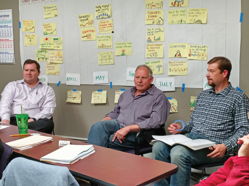 Southern Humboldt Community Healthcare District CEO Matt Rees, left, meets with Rob Eskridge and Ryan Stock of Growth Management Center, the consultants helping to update the district's strategic plan.  (Photo by Kent Scown)