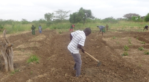 Preparing soil to receive seed and preparing hearts to receive God's Word ~ Kenya