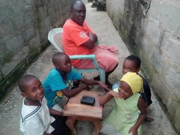 Mr. Mkude and His Grandchildren Around Proclaimer – Tanzania