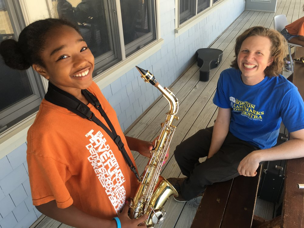 David works with a camper at Camp Harborview during a Boston Landmarks Orchestra outreach event.