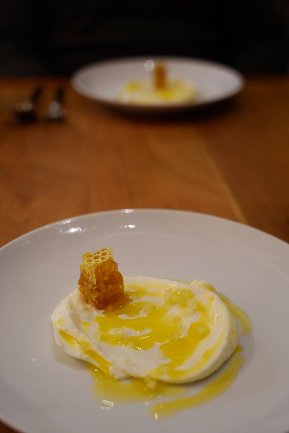 Frozen yogurt, arbequina olive oil and honeycomb.